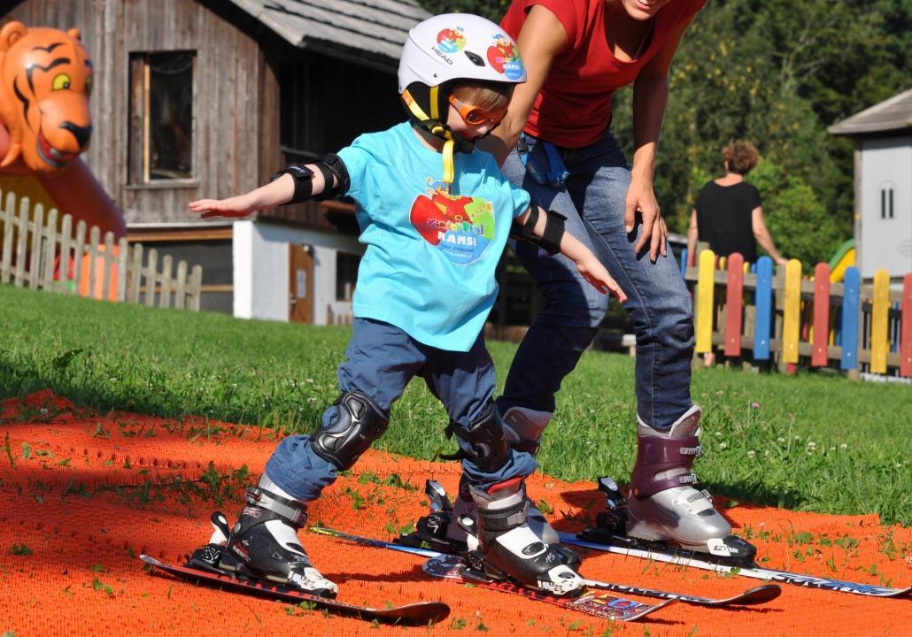 Kinderhotel Ramsi - magic carpet for skiing in the green