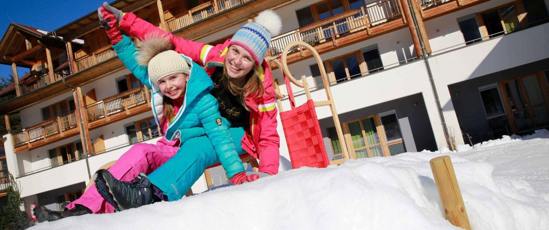 Familienurlaub am Nassfeld im Kinderhotel Ramsi - Schlitten